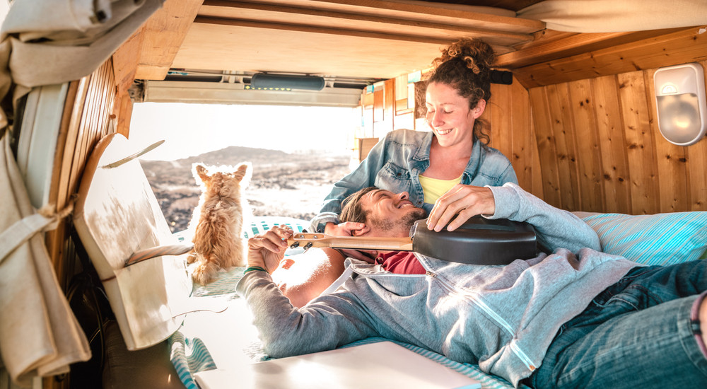 Happy couple camping with dog